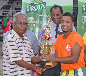 Guyana Beverage Company Berbice Manager Nanlall Boodram presents the winner's trophy to RHTG&G Captain Shawn Pereira.