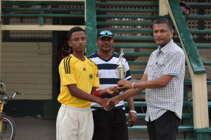 DCB Vice-President, Anand Sanasie presenting Malcolm Hubbard with his man-of-the-match trophy