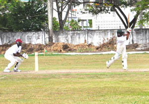 Avinash Sewkarran uses his feet to hit a boundary at DCC yesterday during his 106