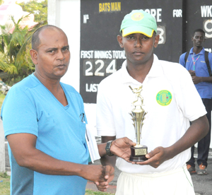 Man of the match Ryan Shun (right) collects his award from chairman of the GCB junior selection panel Nazimul Drepaul