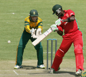 Elton Chigumbura scored 90 of his team's 165 runs © AFP