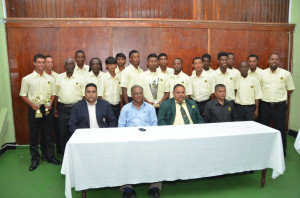 Executives of the Guyana Cricket Board and Director of Sport Neil Kumar share a proud moment with the Guyana Under-19 team which copped the Regional Three-day title for the first time since 2007 (Photo: Carl Croker)