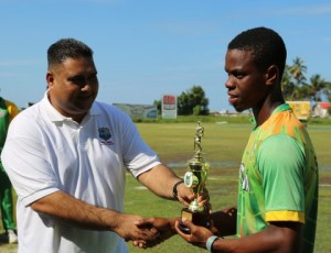 GCB Treasurer handing over the MVP trophy to Shemroy Hetmyer