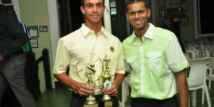 Passing on the mantle! MVP Tagenarine Chanderpaul displays his two trophies in the presence of his illustrious father, the prolific West Indies middle-order batsman Shivnarine Chanderpaul
