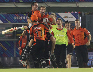 Mitchell Marsh is mobbed by his team-mates after the win © BCCI