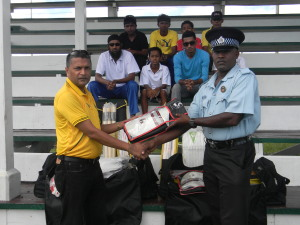 Michael Newland, Station Sergeant, First Division,Central Berbice. Receiving the kit from GCB Secretary, Anand Sanasie