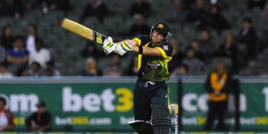 Steven Smith clubs the ball over mid-off © Getty Images