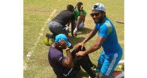 Four members of the Guyana Jaguars unit, Devendra Bishoo and Veerasammy Permaul (forefront) and Raymon Reifer and skipper Leon Johnson (background), do some abdominal stretches