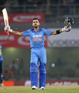 Virat Kohli raises his bat after reaching a century © BCCI