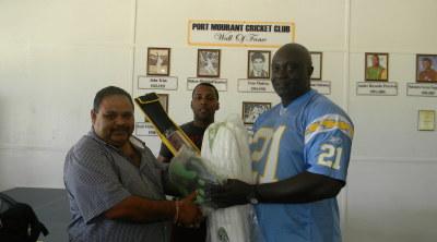 GCB President, Drubahadur (left), hands over the kit to Linden Murray, CDO at Skeldon Estate, in the presence of BCB Head Coach Julian Moore