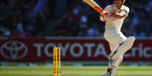 David Warner swivels on his toes to pull © Cricket Australia/Getty Images