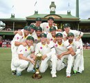 The Australian team with the Border-Gavaskar Trophy after the draw at the SCG © Getty Images