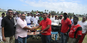 1.GCB President, Drubahadur, hands over kit to Christopher Singh from Lusignan. Also in photo are Jitlall Jowharilall from Enterprise (1st from right), Delbert Hicks, from Rosehall Youth and Sport Club (2nd from right) and GCB Secretary, Anand Sanasie (1st from left)