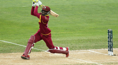 Jonathan Carter hits down the ground © ICC