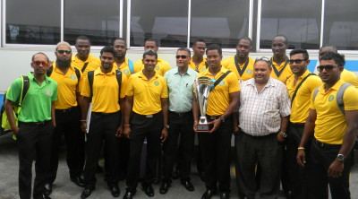 President (third from right) and Secretary (centre) with the Guyana Jaguars team