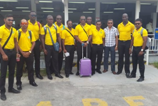 Guyana Jaguars team pose for a photo with GCB Secretary, Anand Sanasie