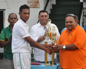 Akshaya Persaud collects his Man-of-the-Match trophy from GCB President Drubahdur