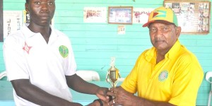 Man of the match Sherfene Rutherford collects his trophy from former West Indies batsman Alvin Kallicharran