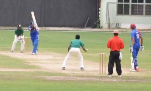 Gaursnshu Sharma gathers runs off his legs off left-arm spinner Ashmead Nedd during his gritty 36