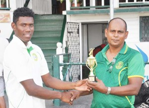 Keemo Paul accepts his prize from selector Nazium Drepaul