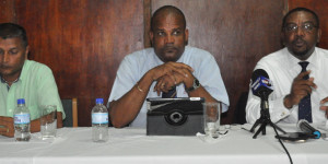 WICB President WICB Whycliff Dave Cameron (right) addresses the gathering. At center is Vice President Emmanuel Nanthan and Director Anand Sanasie is at left