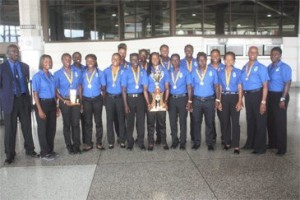 Champs Barbados return home