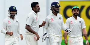Indian cricketer Ravichandran Ashwin (2L) celebrates with his teammates after he dismissed Sri Lankan cricketer Dinesh Chandimal during the final day of the second Test cricket match between Sri Lanka and India at the P. Sara Oval Cricket Stadium in Colombo on August 24, 2015. AFP PHOTO / LAKRUWAN WANNIARACHCHI        (Photo credit should read LAKRUWAN WANNIARACHCHI/AFP/Getty Images)