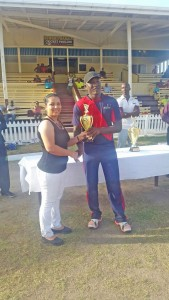 Man-of-the-Match Royston Crandon receives his trophy from GCB Assistant Administrator, Melinda Bishundyal-Chaitram