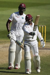 Denesh Ramdin raises his bat after reaching his fifty © Getty Images