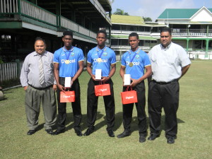 GCB President Drubahadur (left) and Treasurer Anand Kalladeen, pose for a picture with Keemo Paul, Shimron Hetmyer and Tevin Imlach