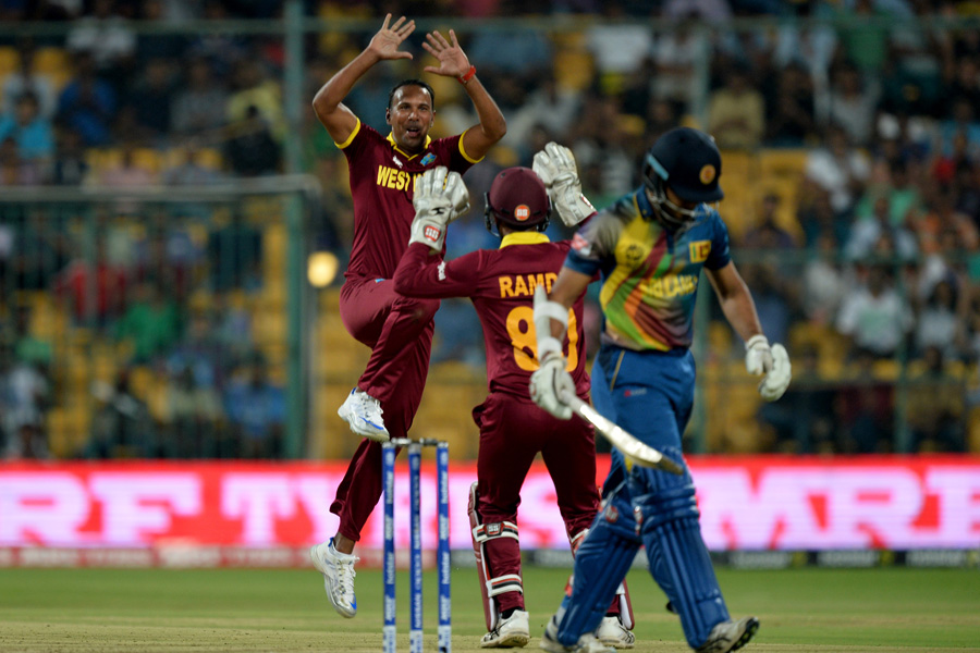 West Indies bowler Samuel Badree (L) celebrates the wicket of Sri Lankan batsman Milinda Siriwardana