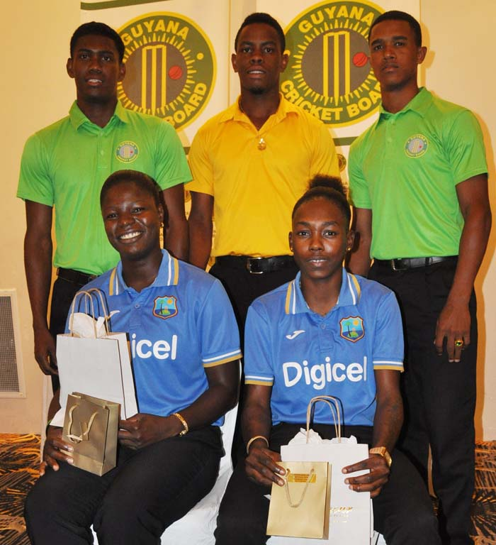 From extreme right standing, Kemo Paul, Shemron Hetymer and Tevin Imlach. Sitting, Tremayne Smartt (left) and Shamaine Campbell were honored for being members of West Indies World Cup success this year