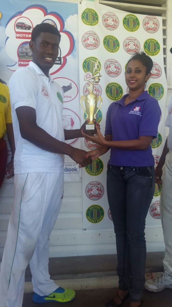 Man-of-the-match Keemo Paul receiving his trophy from Hand-in-Hand representative