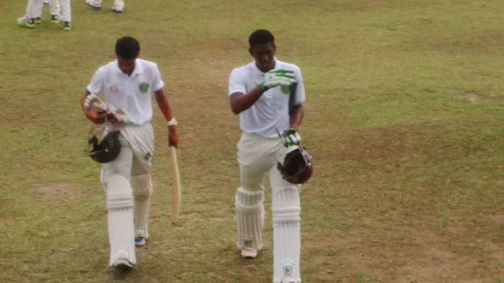 Essequibians Keemo Paul and Sachin Persaud walking off the field at the end of the first day's play