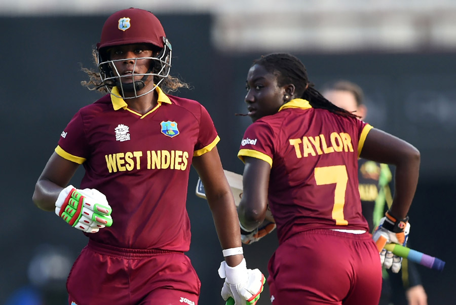 West Indies's Hayley Matthews(L)and captain Stafanie Taylor run between the wickets during the World T20 cricket tournament women's final match between Australia and West Indies at The Eden Gardens Cricket Stadium in Kolkata