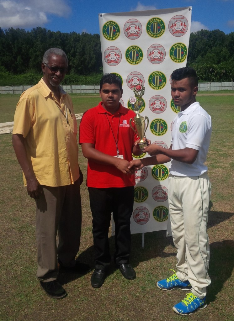 Man-of-the-match Renaldo Renee receiving his trophy from Hand-in-Hand representative