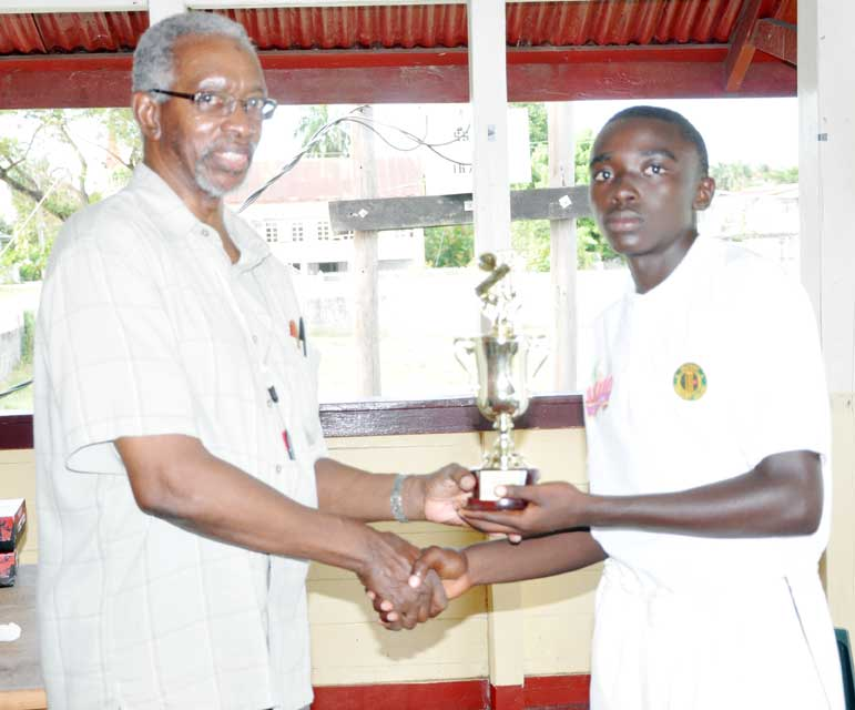 Man of the match Reon Venture from Essequibo, accepts his prize from Match Referee Grantley Culbard
