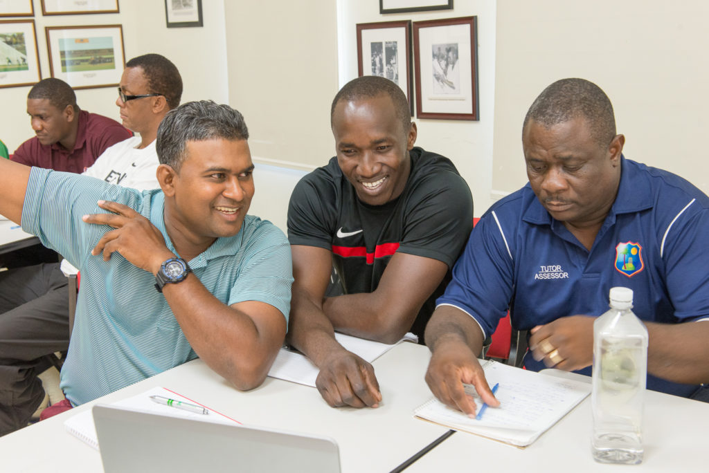 Guyanese Coach, Rayon Griffith (centre)