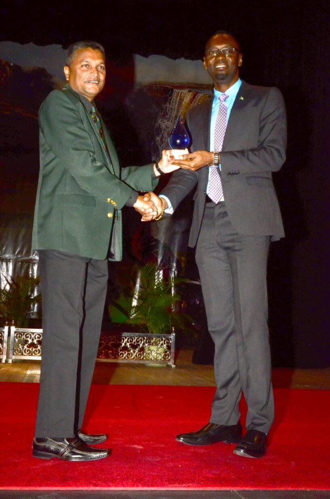 "GCB Secretary, Anand Sanasie, receiving the ""Association/Federation of the Year 2015"" award which GCB won (Adrian Narine Photo)"