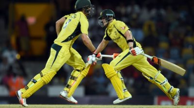 Australian cricket team captain Steven Smith (R) and his teammate Mitchell Marsh take a run during the 8th One Day International match of the Tri-nation Series between Australia and West Indies at the Kensington Oval stadium in Bridgetown on June 21, 2016. / AFP / Jewel SAMAD        (Photo credit should read JEWEL SAMAD/AFP/Getty Images)