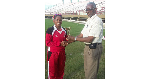 Anisa Mohammed collects her Player-of-the-Match trophy from Grantley Culbard