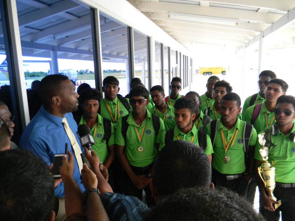 Director of Sports, Christopher Jones, meeting the victorious U-19 50-Overs team on their arrival home