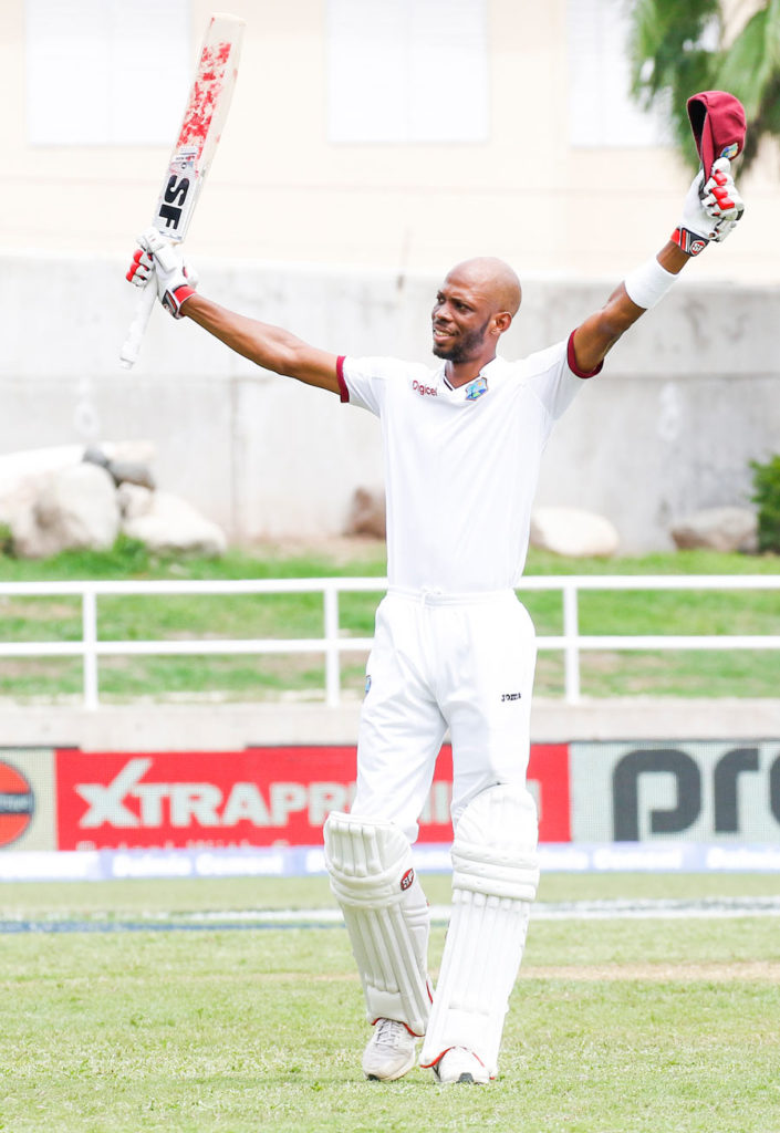 Roston Chase raises his bat after bringing up his maiden Test hundred, West Indies v India, 2nd Test, Kingston, 5th day, August 3, 2016 ©WICB Media Photo/Athelstan Bellamy