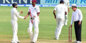 India's captain Virat Kohli and Roston Chase of the West Indies congratulate one another at the end of their match on day five of their Second Test cricket match on August 3, 2016 at Sabina Park in Kingston, Jamaica which ended in a draw. / AFP / Frederic J. BROWN        (Photo credit should read FREDERIC J. BROWN/AFP/Getty Images)