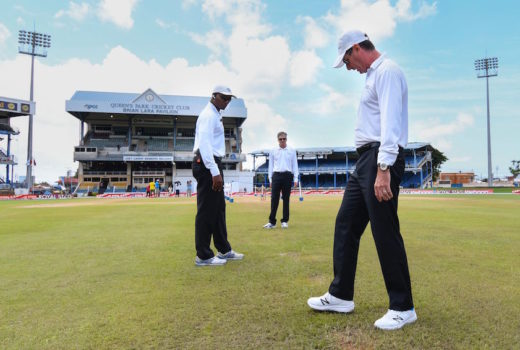 Umpire Rod Tucker (R) Nigel Llong (C) and Gregory Brathwaite (L) inspect the pitch and out field during day 2 of the 4th and final Test between West Indies and India at Queen's Park Oval in Port of Spain, Trinidad on August 19, 2016. / AFP / Randy BROOKS        (Photo credit should read RANDY BROOKS/AFP/Getty Images)