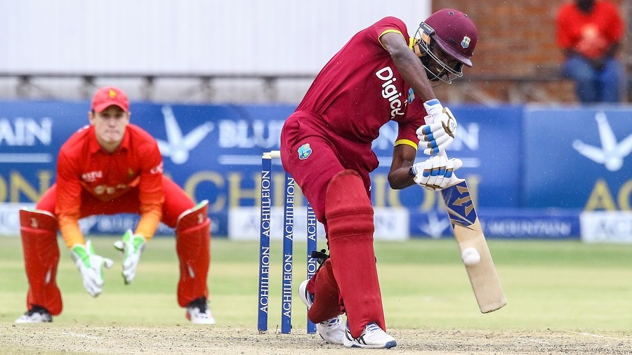 West Indies batsman Jonathan Carter (R) plays a ball during the sixth match in the Blue Mountain Achilleion tri-series played between West Indies and hosts Zimbabwe at the Queens Sports Club in Bulawayo, November 25, 2016. / AFP / Jekesai Njikizana (Photo credit should read JEKESAI NJIKIZANA/AFP/Getty Images)
